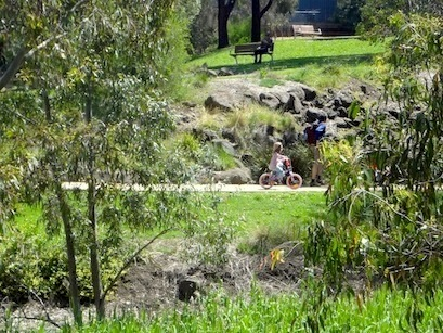 Family cycling at Merri Creek path