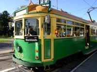 yellow and green Melbourne tram